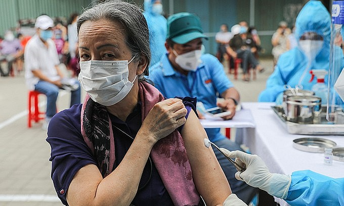 A woman receives a Covid-19 vaccine shot in HCMC's Go Vap District, August 14, 2021. Photo: VnExpress
